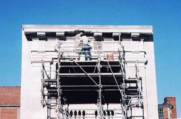 Crew Worker Cleaning the Masonry