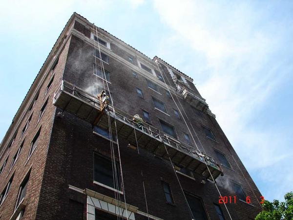 Crew Cleaning Brick Building