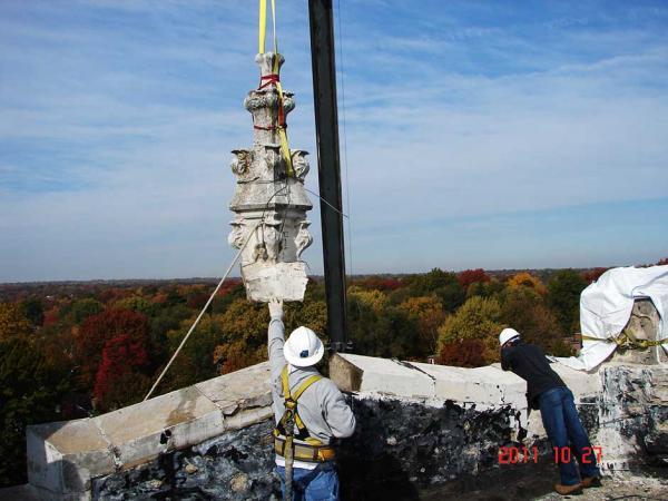 Crew Members Repairing a Stone Building