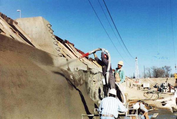 Crew Spraying Dry Process Gunite
