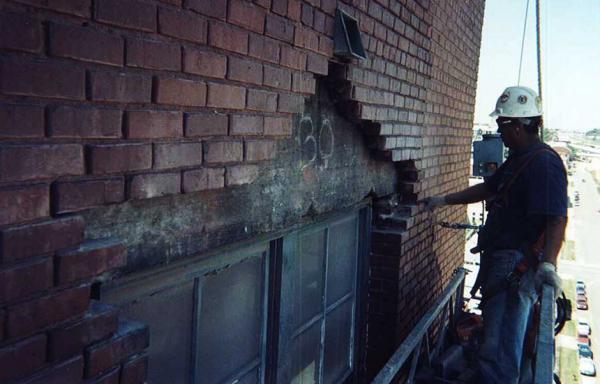 Brick Mason Repairing Thru Wall Flashing