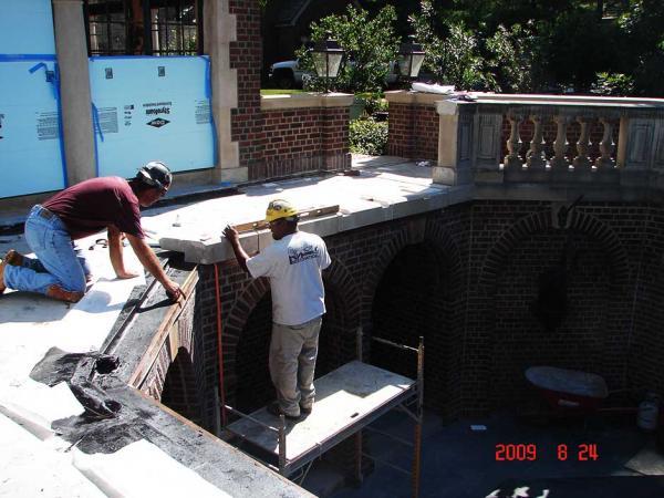 Crew Members Repairing Stone
