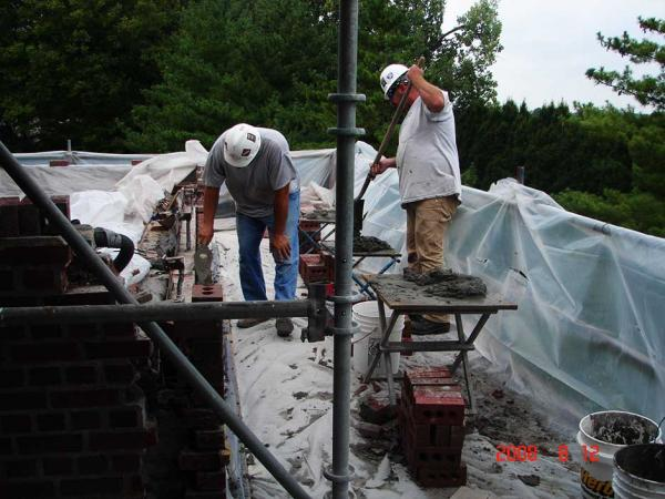 Crew Working on Masonry Restoration Project
