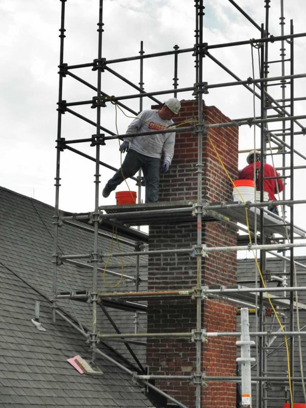 Crew Working on a Chimney