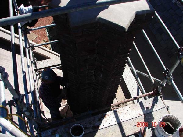 Crew Member Repairing a Chimney