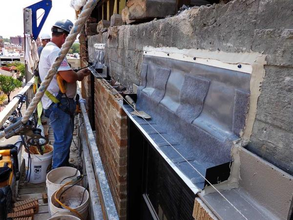 Crew Member Installing Thru Wall Flashing